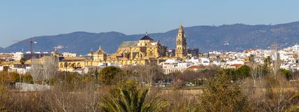 Old Mezquita Cathedral of Cordoba city above Guadalquivir river in Andalusia, Spain. Exterior of old Mezquita Cathedral of Cordoba city above Guadalquivir river stock image