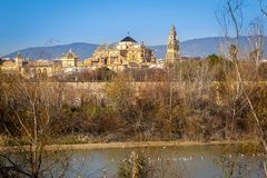 Old Mezquita Cathedral of Cordoba city above Guadalquivir river in Andalusia, Spain. Exterior of old Mezquita Cathedral of Cordoba city above Guadalquivir river stock images