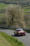 An old MG in spring countryside landscape Royalty Free Stock Images