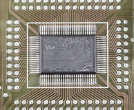 Old microcircuit on circuit board surface Royalty Free Stock Images
