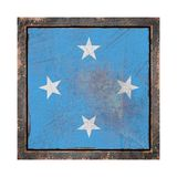 Old Micronesia flag. 3d rendering of a Micronesia flag over a rusty metallic plate in an old frame. Isolated on white background Royalty Free Stock Photo
