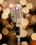 Old microphone. With unfocused light Royalty Free Stock Images