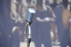 Old microphone. Background old microphone on stage Royalty Free Stock Photography
