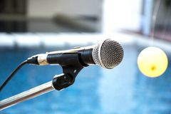 Old microphone with blurred background,. Outdoor banquet Stock Photo