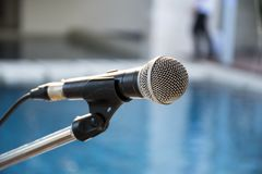 Old microphone with blurred background. Outdoor banquet Stock Image