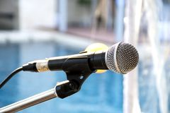 Old microphone with blurred background. Outdoor banquet Royalty Free Stock Photography