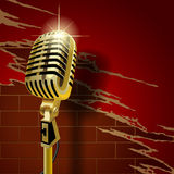 Old microphone on the brick wall. Gold old microphone on the brick wall background with torn wallpaper. Retro music club concept. There is in addition a vector Royalty Free Stock Photography