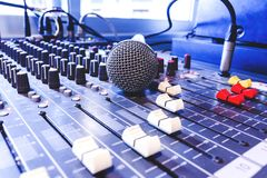 Old microphone. Old microphone in control room. Cool Tone royalty free stock photo