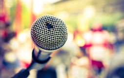 Old microphone in front of colorful background. Selective focus and Close up detail image Royalty Free Stock Photos