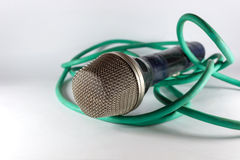 Old microphone with green cable Royalty Free Stock Images