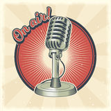Old microphone made in grunge style Royalty Free Stock Image