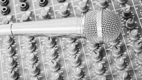 Old microphone on mixer. In studio ,Black and white tone Stock Images