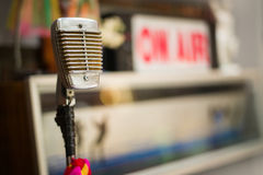 The old microphone in the recording room. Old microphone, multicolored tape in the recording room Royalty Free Stock Photography