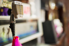 The old microphone in the recording room. Old microphone, multicolored tape in the recording room Stock Photos