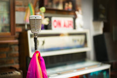 The old microphone in the recording room. Old microphone, multicolored tape in the recording room Royalty Free Stock Photos