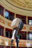 The old microphone on stage. The old microphone waiting for the live performance of the singer in the ancient theater Stock Image