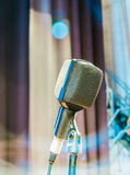 The old microphone on stage. The old microphone waiting for the live performance of the singer for the next show Royalty Free Stock Images