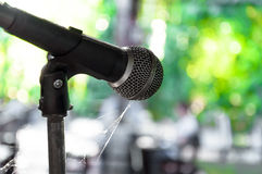 Old microphone on the stage wasteful abandoned. Select focus Royalty Free Stock Photo