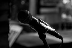Old microphone on the stage wasteful abandoned. Select focus Stock Images