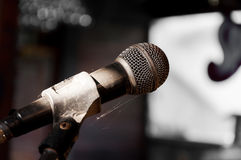 Old microphone on the stage wasteful abandoned. Select focus Royalty Free Stock Image