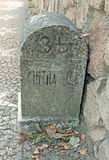 Old milestone on cobblestone road in Portugal Royalty Free Stock Photography