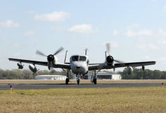 Old military airplane. Retired US Navy reconnaissance airplane taxiing on the ground Stock Photo