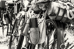 Old military bicycle with kitbag and equipments, black and white Stock Photo