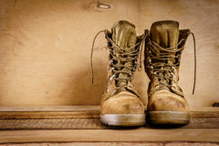 Old military boots on the table Stock Images