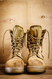Old military boots on the table Stock Photos