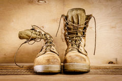 Old military boots on the table Royalty Free Stock Images