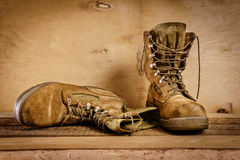Old military boots on the table Stock Photo