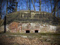 Old military bunker in forest. Stock Photo