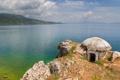 Old military bunker in Lin village, Albania. Old military bunker in Lin village. Ochrid lake in background. Albania royalty free stock image