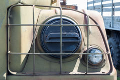 Old military car headlight reflector closed rusty grid Stock Photography