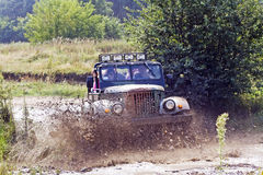 Old military car off-road racing Royalty Free Stock Photos
