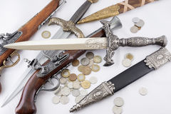 Old military daggers, guns and coins. On white background Stock Photo