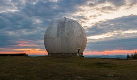 Old giant dome of a radar antenna of a Ukrainian military base. Apocalyptic view. royalty free stock photos