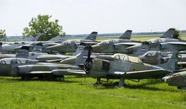 Old military fighter jets. In the field Stock Photo