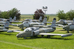 Old military fighter jets. In the field Royalty Free Stock Image