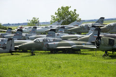 Old military fighter jets. In the field Stock Images
