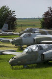 Old military fighter jets. In the field Stock Photos