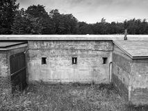 Old military fort wall with riffle slits,  black and white. Old ,ilitary fort wall with riffle slits, black and white Royalty Free Stock Photo