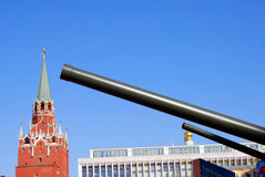Old military machine barrels and Moscow Kremlin tower. Royalty Free Stock Photography