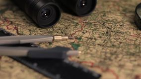 Old military map with binoculars, divider anr ruler stock footage