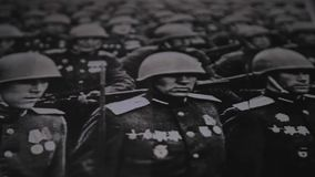 Old military photo of the second world war. Soldiers marching. Close-up in motion. Historical memory stock footage