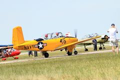Old military plane ready for takeoff. Old yellow aircraft ready to take off. US Navy yellow 1957 Beech D-45 T-34 Mentor, 1944 AT6-D. 2014 Memorial Day, Miami stock photo