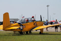 Old military plane. Old yellow aircraft. US Navy yellow 1957 Beech D-45 (T-34 Mentor), 1944 AT6-D. 2014 Memorial Day, Miami royalty free stock photo