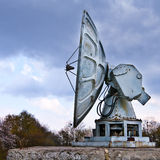 Old military radar. Over cloudy sky Stock Image