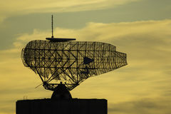Old military radio tower antenna at sunset Royalty Free Stock Images