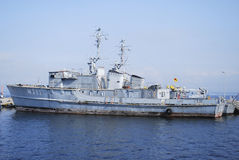 Old military ship in harbour. Old military ship in peaceful harbour Royalty Free Stock Images